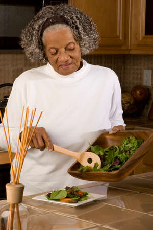 vegtables: Happy elderly African American woman at her house.