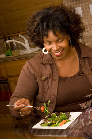 vegtables: African American woman living a healty lifestyle. Stock Photo