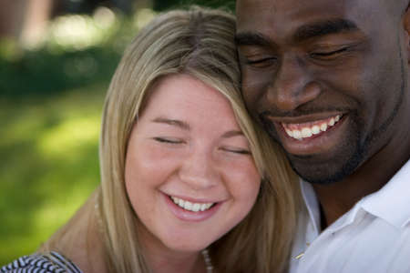 young wife: Happy loving multicultural couple hugging and smiling.
