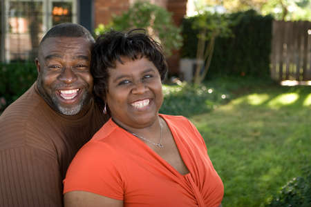 american: Mature African American couple laughing and hugging.