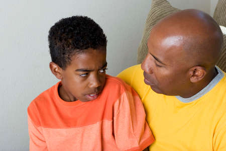 African American father having difficulty parenting his son. Stok Fotoğraf