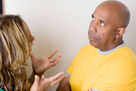Unhappy couple arguing and having relationship problems.
