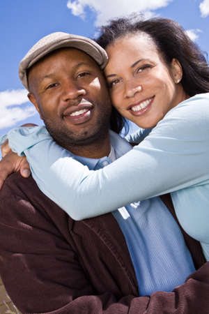 romantic man: Happy African American couple laughing and smiling. Stock Photo
