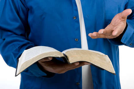 unrecognisable people: Unrecognizable African American man reading the Bible.