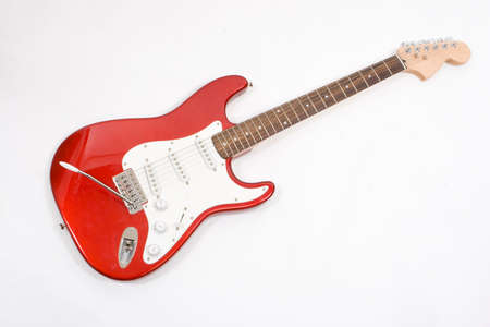 humbucker: Vintage red electric solid body guitar, isolated on white. Stock Photo