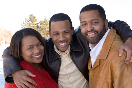 African American family and their adult son.