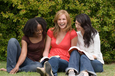 book club: Diverse woman in a small group reading. Stock Photo