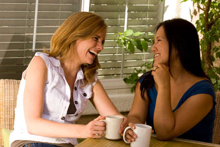 women coffee: Diverse group of women having coffee and talking.