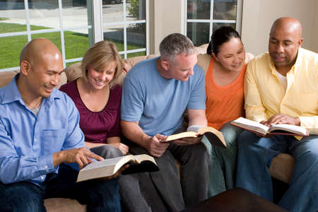 Portrait Of Friends At Home Bible Study Stock Photo