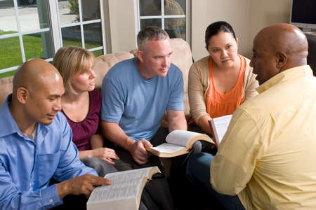 Portrait Of Friends At Home Bible Study Banco de Imagens