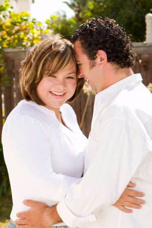 Happy hispanic couple laughing and smiling.