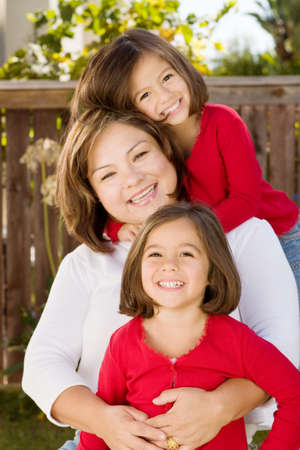 multiples: Happy Hispanic mother and her daughter.