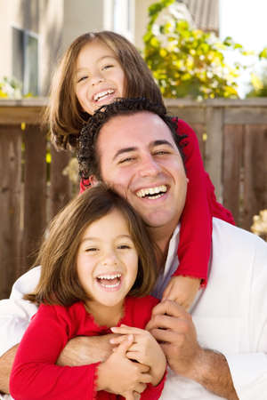 multiples: Happy Hispanic father and his daughter.