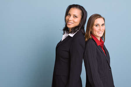 woman business suit: Happy confident businesswomen smiling at work