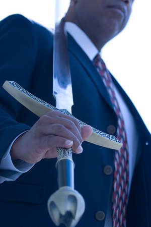 African American Businessman holding a sword.
