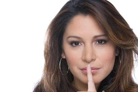 Hispanic woman making hand gesture isolated on white. Stock Photo