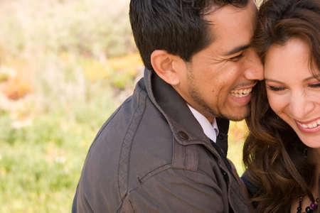 spanish ethnicity: Beautiful Hispanic couple laughing and smiling. Stock Photo