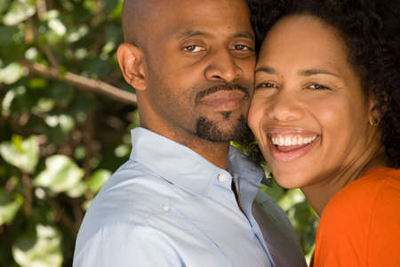 jamaican adult: Romantic African American couple hugging outside. Stock Photo