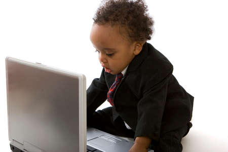 Prodigy: African American little boy surfing the internet.