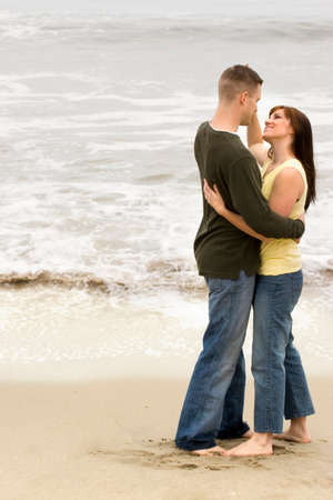 Couple share romantic moments on the beach. Stock Photo
