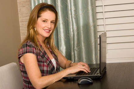 home office: Woman working from her home office.