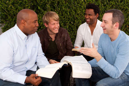 Diverse group of men studying together.