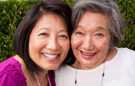 Mature Asian mother and her adult daughter. Stock Photo