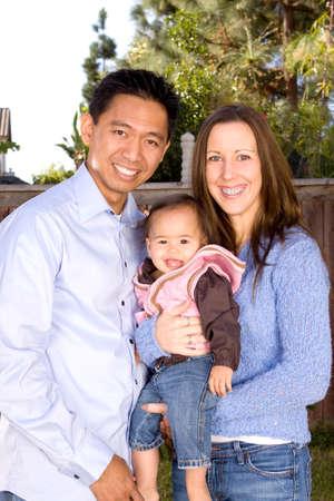 Portrait of a happy biracial family. Stock Photo