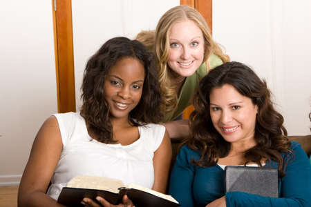 Diverse group of women studing together.