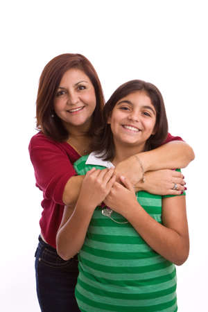 Happy Hispanic mother and daughter.