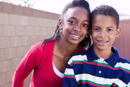 pre teen boy: Happy African American brother and sister smiling.