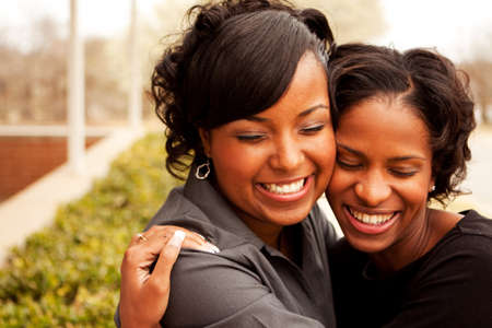 Happy African American women laughing and smiling. Stock Photo