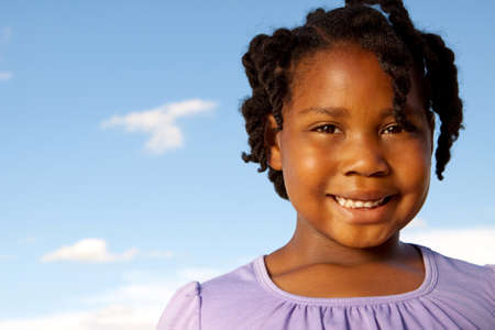 Happy African American girl smiling outside. Reklamní fotografie