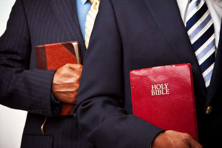 African American businessmen holding the Bible Stock Photo - 79414144