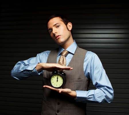 oclock: Well Dressed Man holding a clock.