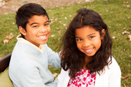 Brother and sister smiling and laughing. Stock Photo