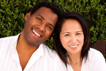 Portrait of a happy biracial couple.