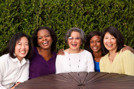 aging american: Diverse group of women talking and laughing. Stock Photo