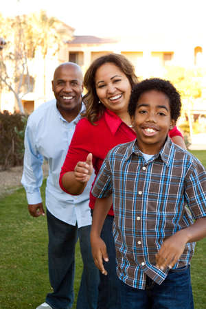 Multiethnic family smiling and laughing.