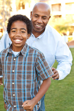 African American father and son playing and laughing.