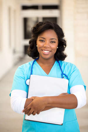 Healthcare worker. Doctor or nurse standing outside the hospital. Stock Photo