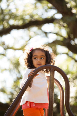 Little girl playing at the park. Stock Photo