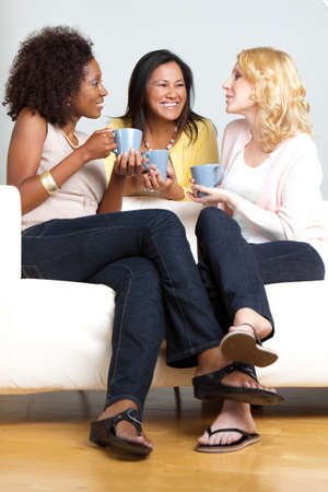 Diverse group of friends having coffee and talking. Stock Photo