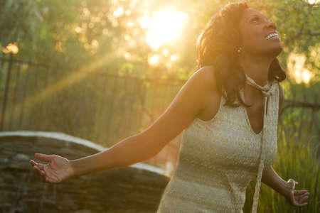 Excited African American woman with open arms. Stock Photo