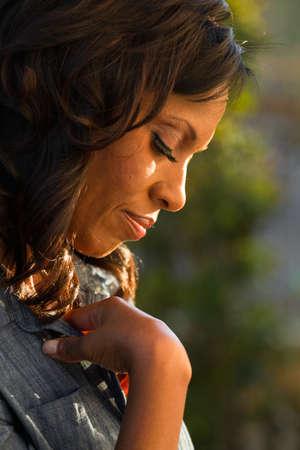 humility: Closeup of a woman praying. Stock Photo