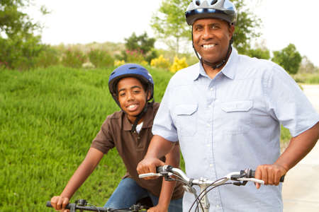Father and son riding bikes.