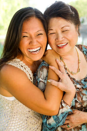 Asian mother and her adult daughter. Stock Photo