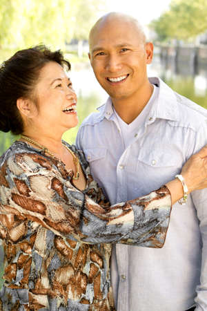 Asian mother and her adult son. Stock Photo