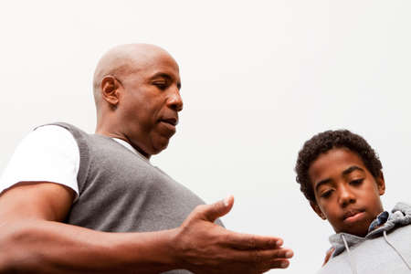 African American father parenting his son. Stock Photo