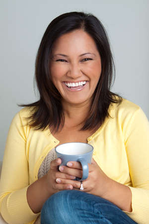 environmental issues: Asian woman drinking coffee in the morning.